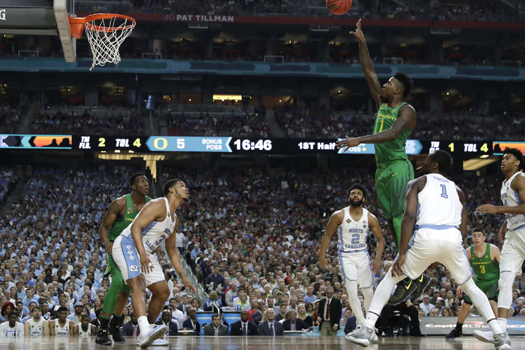 Copyright 2017 The Associated Press. All rights reserved. This material may not be published, broadcast, rewritten or redistributed without permission.Mandatory Credit: Photo by AP/REX/Shutterstock (8561410m)Oregon forward Jordan Bell (1) shoots over North Carolina forward Kennedy Meeks (3) during the first half in the semifinals of the Final Four NCAA college basketball tournament, in Glendale, ArizFinal Four Oregon North Carolina Basketball, Glendale, USA - 01 Apr 2017
