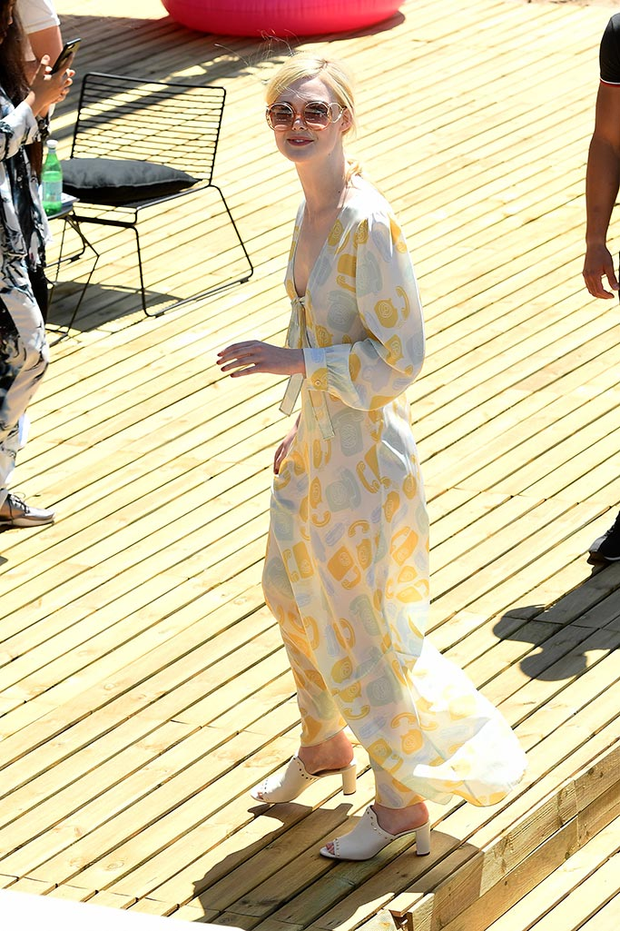 elle fanning in cannes on may 20 wearing miu miu dress and jimmy choo shoes