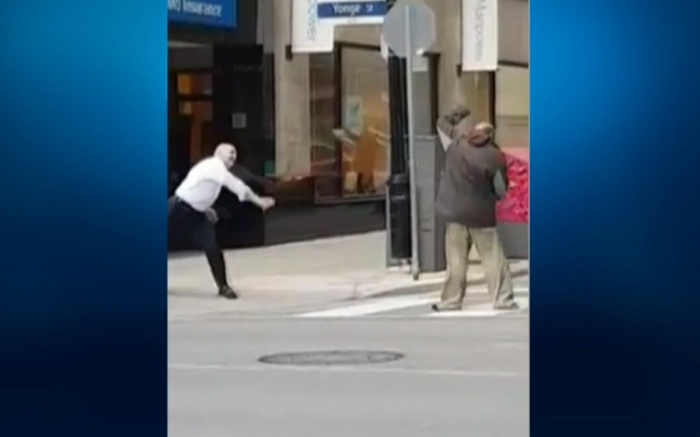 Security Guard Throws Shoe at Homeless Man