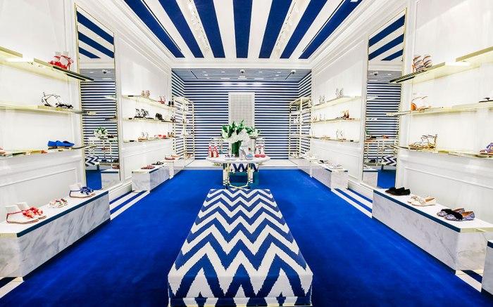 the Aquazzura Boutique in Costa Mesa, California features blue and orange interior design details