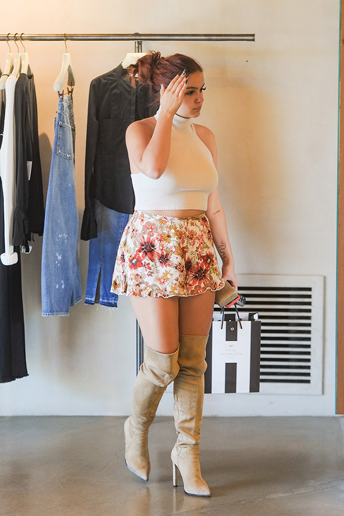 riel winter, actress of modern family wears thigh high nude boots in los angeles while shopping