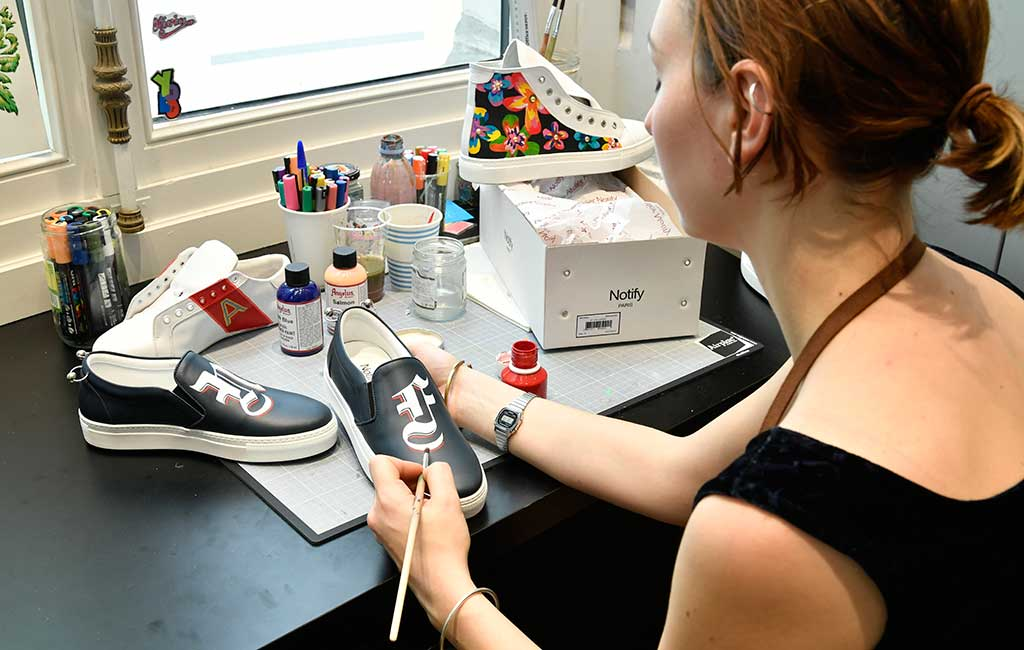 Sneaker customization at Le Bon Marche.