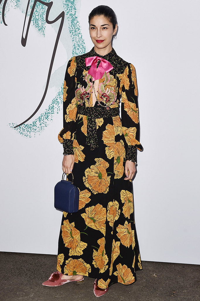 Caroline Issa wears velvet shoes with Gucci floral dress at The Summer Party presented by serpentine galleries and chanel