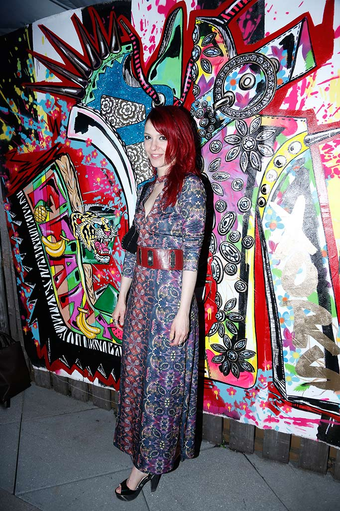 Artist Renée Snelson poses in front of her piece.