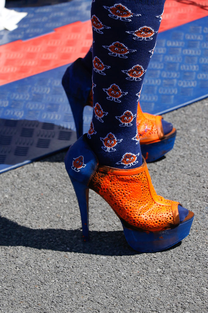 A competitor shows off orange and blue heels at last year's annual Socci Stiletto Run