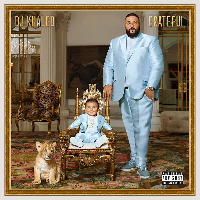 "DJ Khaled and son Asahd match in custom blue suits for the producer's ""Grateful"" album"