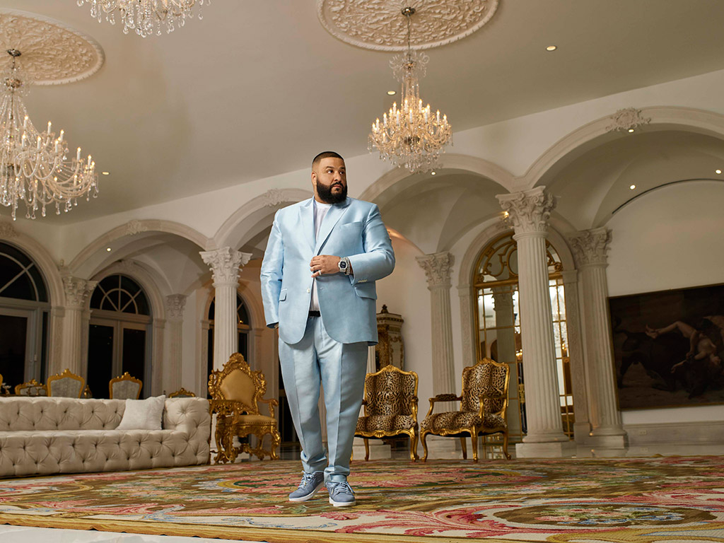 DJ Khaled in a custom sateen suit and Nikes.