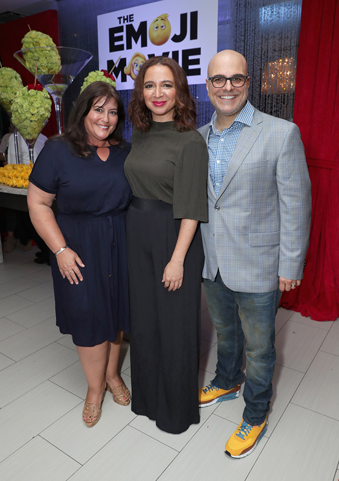 Michelle Kouyate, Maya Rudolph and Tony Leondis inside the party.