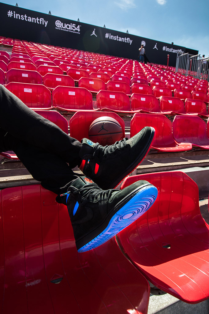 The limited edition Quai 54 Jordan sneakers in black, red and blue.