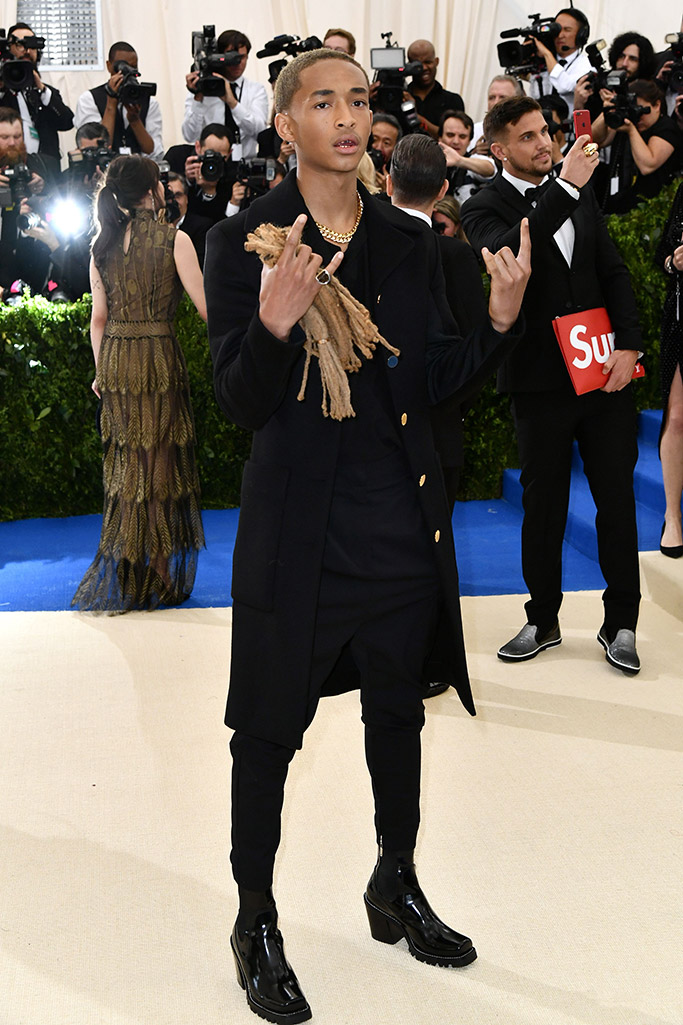 Jaden Smith at the 2017 Met Gala wearing Louis Vuitton and carrying his hair as an accessory.