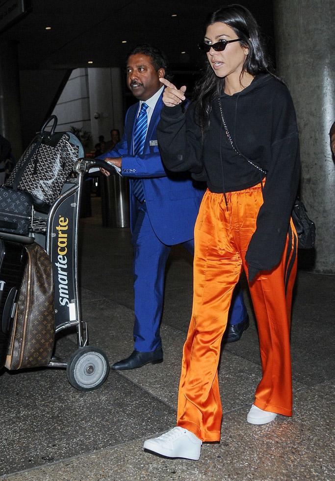 kourtney kardashian, orange, pants, sneakers