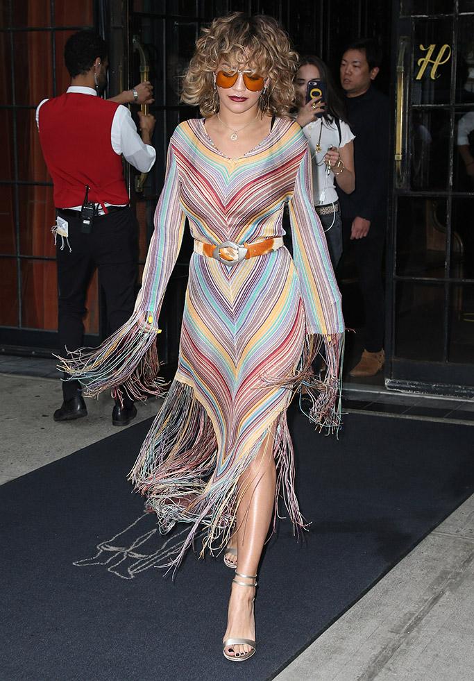 Rita Ora wears a striped fringed dress in NYC.