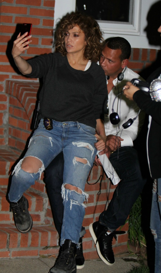 Jennifer Lopez S Sultry Style With A Rod On Set In Combat Boots Footwear News