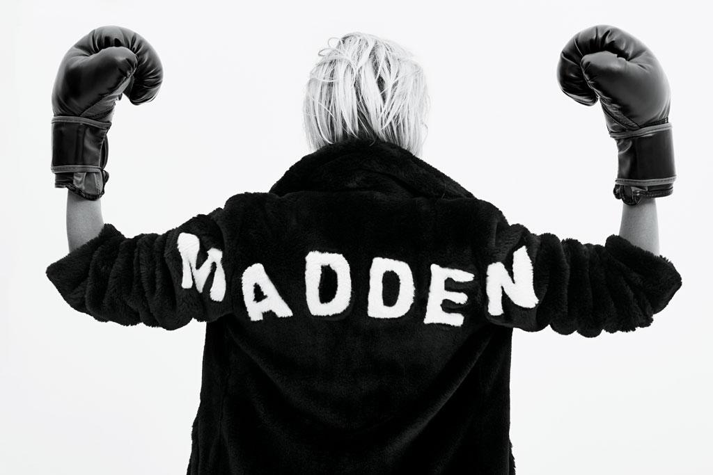 Caroline Vreeland wearing a Steve Madden jacket and boxing gloves