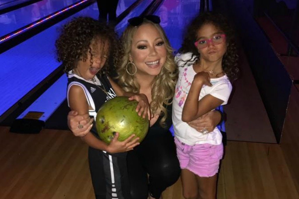 Mariah Carey bowling with her kids in heels.