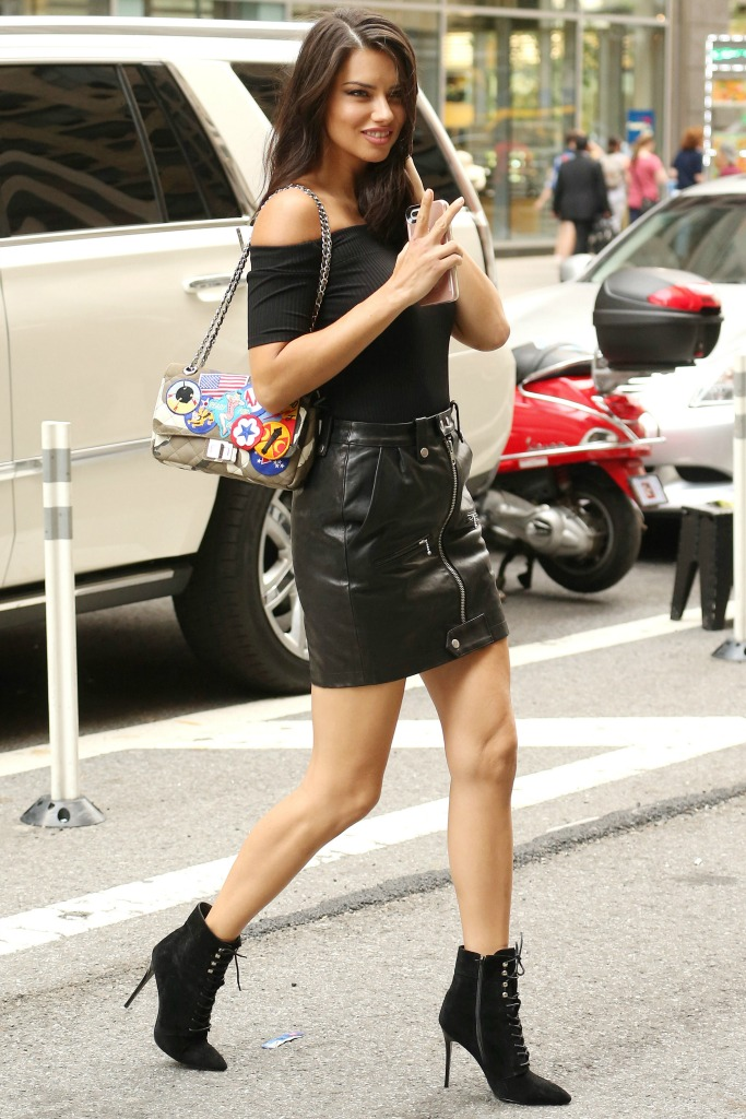 Adriana Lima shows off bare legs over ankle boots, Victoria's Secret fitting, New York