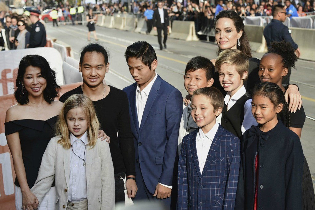 Angelina Jolie with her six children, author Loung Ung and actors Kimhak Mun and Sareum Srey Moch