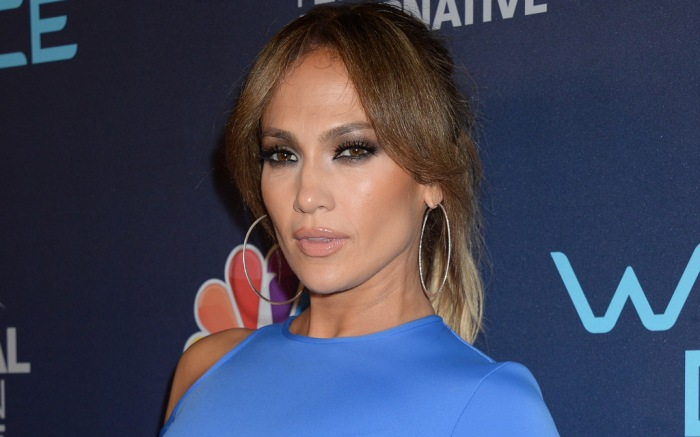 """Jennifer Lopez poses at the """"World of Dance"""" party in Los Angeles, Calif."""