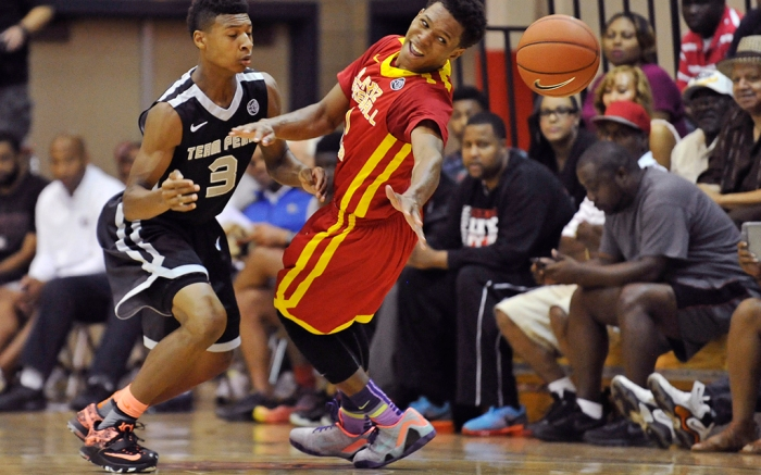 Playaz Basketball's Trevon Duval loses possession of the ball as he is defended by Dillon Mitchell during a basketball game in the Nike EYBL Peach Jam final in North Augusta, S.C., Sunday, July 20, 2014. (AP Photo/The Augusta Chronicle, Jon-Michael Sullivan)