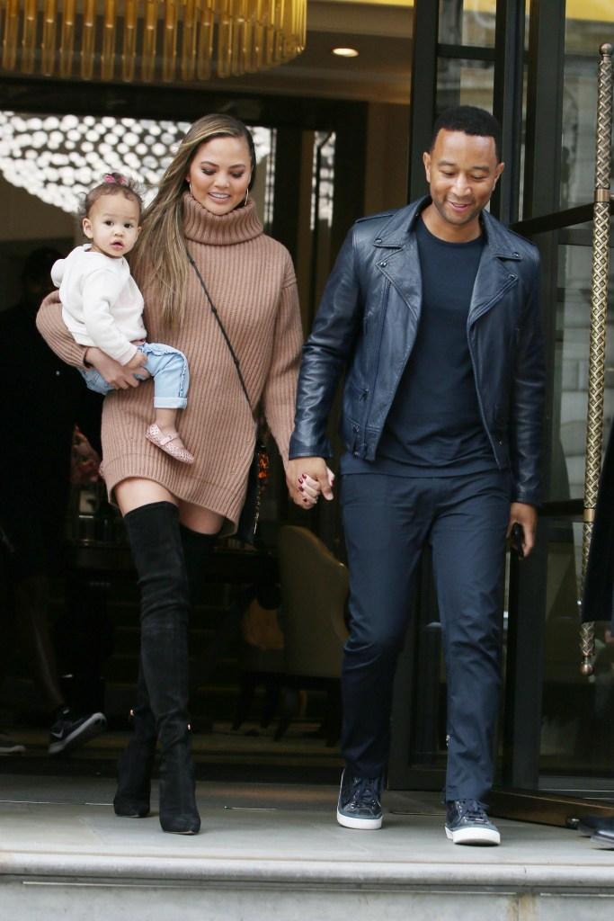 Chrissy Teigen, John Legend and daughter Luna leaving their hotel in London.