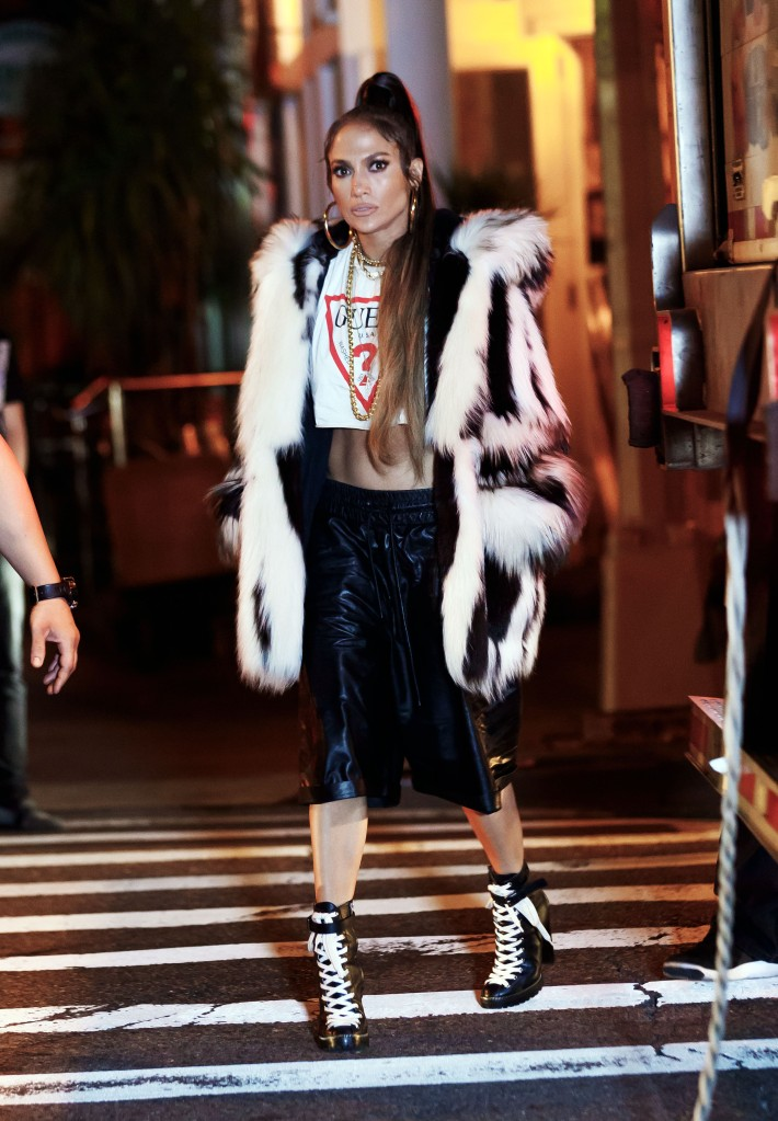 Jennifer Lopez walks over the crosswalk at a video shoot in New York.
