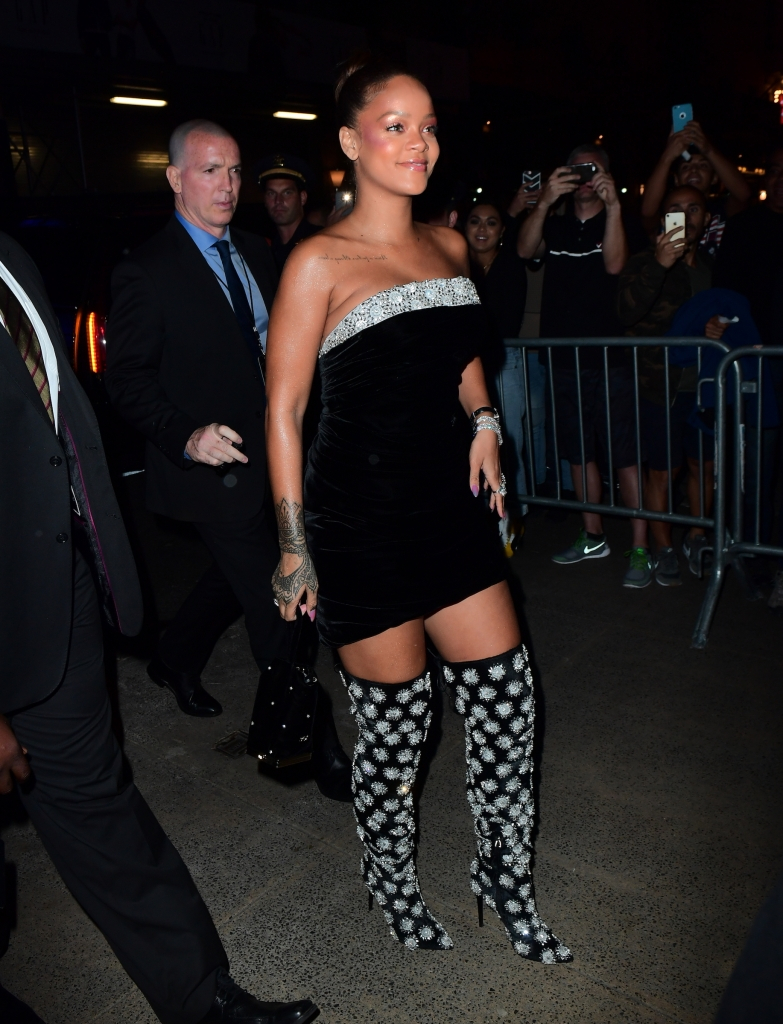 Rihanna arriving at Sephora in the middle of Times Square.