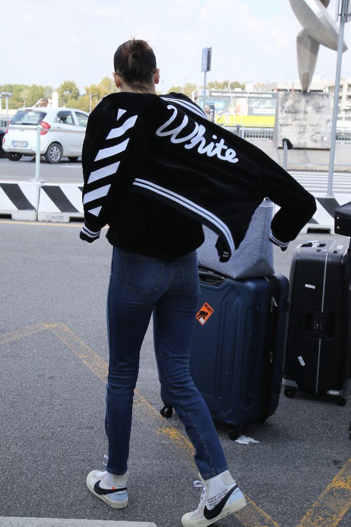 Bella Hadid wearing Nike X Off-White while leaving Milan Fashion Week