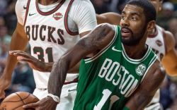 Boston Celtics' Kyrie Irving dishes off
