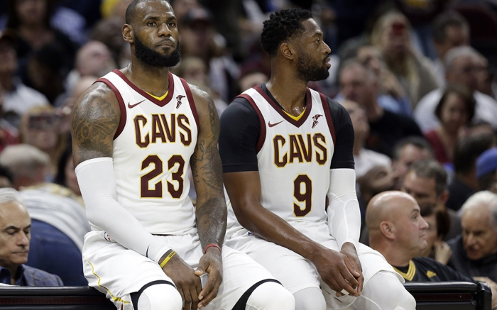 LeBron James, Dwyane Wade. Cleveland Cavaliers' LeBron James (23) and Dwyane Wade wait to re-enter the game against the Boston Celtics in the second half of an NBA basketball game, in ClevelandCeltics Cavaliers Basketball, Cleveland, USA - 17 Oct 2017