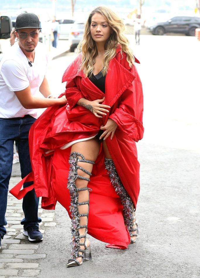 rita ora wearing over-the-knee boots, rita ora music video shoot
