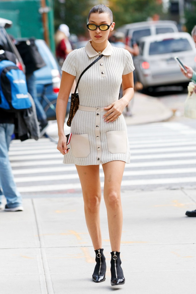 Bella Hadid wearing a sweater dress from Alyx Spring 2018, versace boots and elizabeth and james sunglasses