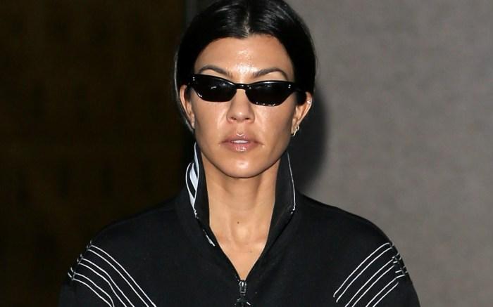 Kourtney Kardashian rocks all black sportswear.