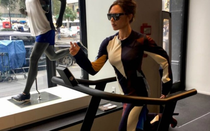 Victoria Beckham works out in heels.