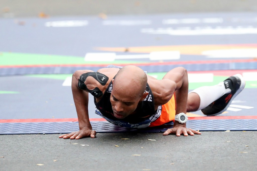Keflezighi collapses after crossing the finish line, new york marathon