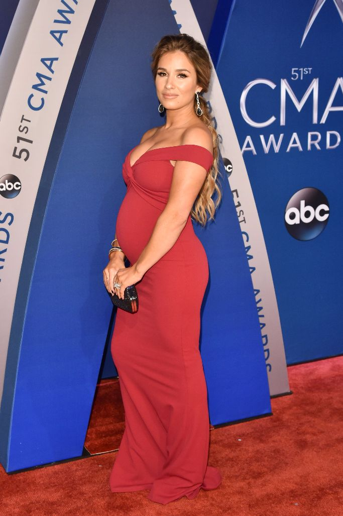 Jessie James Decker wearing a red gown with Christian Louboutin pumps at the CMA Awards