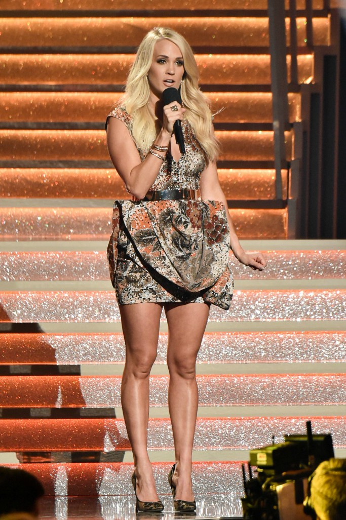 Carrie Underwood wearing lacy pointed pumps on stage at the 51st Annual CMA Awards