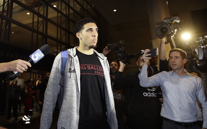 UCLA basketball player LiAngelo Ball is surrounded by reporters and photographers as he leaves Los Angeles International Airport, in Los Angeles. Three UCLA basketball players?Ball, Jalen Hill and Cody Riley?detained in China on suspicion of shoplifting returned home, where they may be disciplined by the school as a result of the international scandalUCLA Players Questioned Trump, Los Angeles, USA - 14 Nov 2017