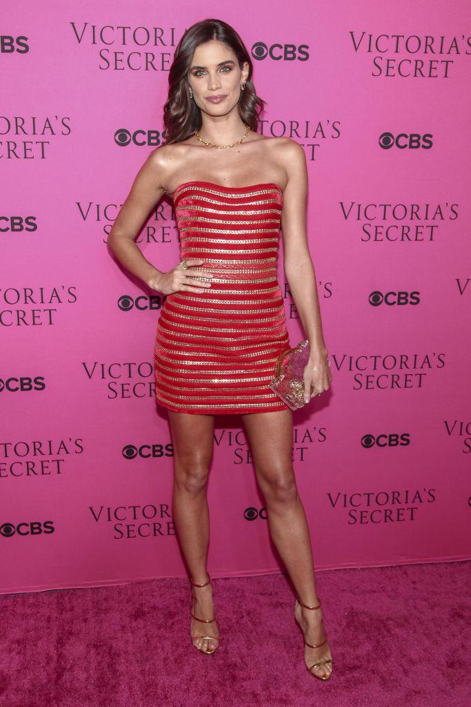 Sara Sampaio rocks red dress for Victoria's Secret event in New York.