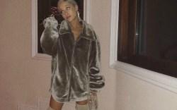 Ariana Grande rocks nude thigh high