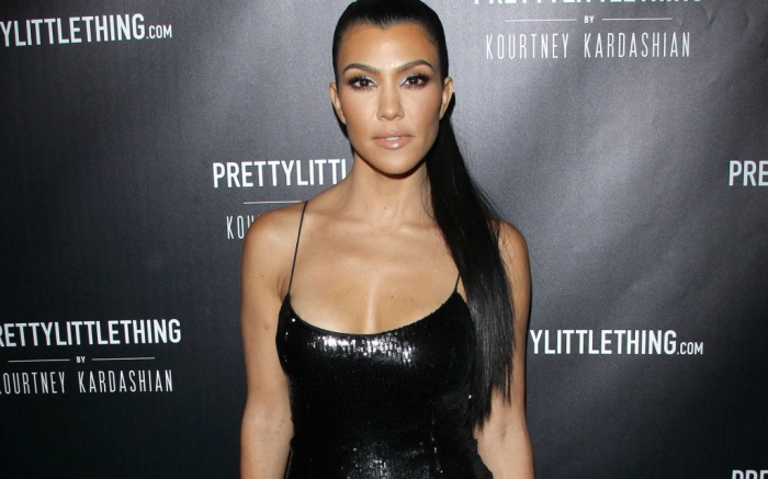 Kourtney Kardashian wears black dress to Pretty Little Thing collection launch.