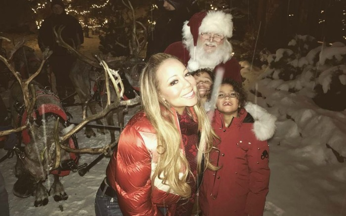 Mariah Carey and her kids hang out with Santa.Mariah Carey and her kids hang out with Santa.