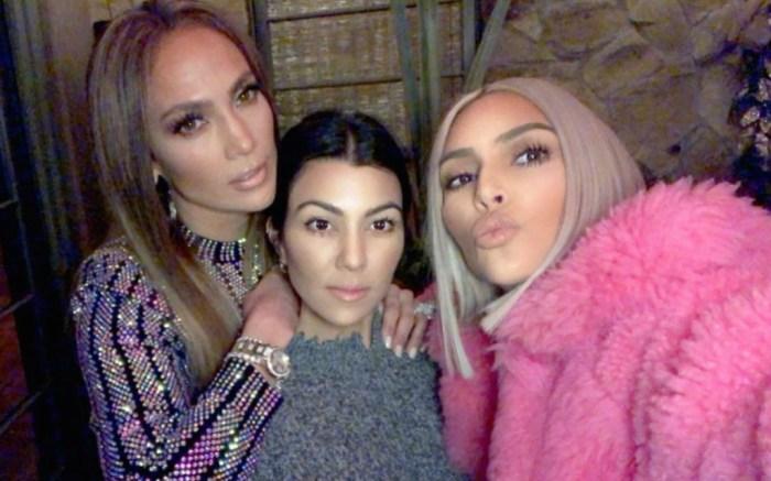 Jennifer Lopez takes a selfie with Kourtney and Kim Kardashian.