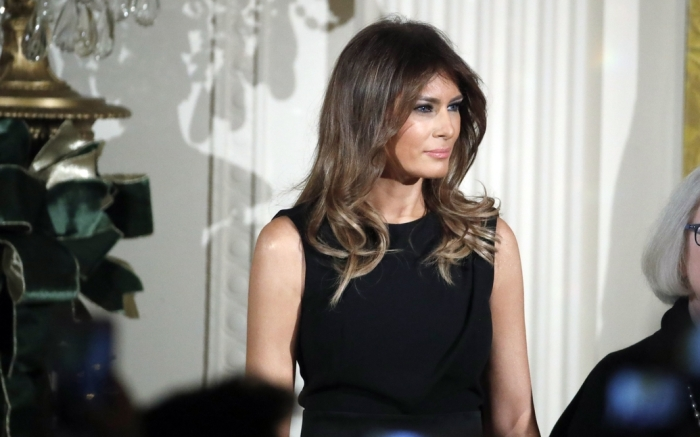 First lady Melania Trump stands while her husband President Donald Trump speaks during a Hanukkah reception in the East Room of the White House, in WashingtonTrump, Washington, USA - 07 Dec 2017