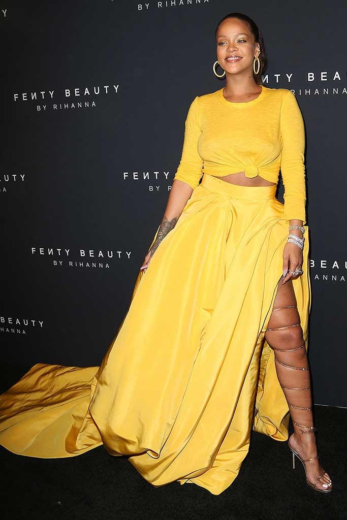 Rihanna celebrates the launch of Fenty beauty wearing yellow Oscar de la Renta.