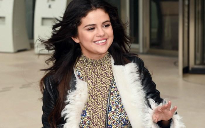 Selena Gomez attends Louis Vuitton show during Paris Fashion Week.