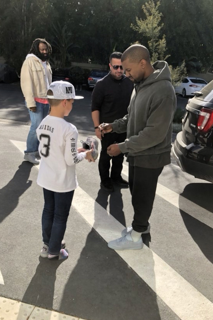 Kanye West Signs Yeezy Shoes