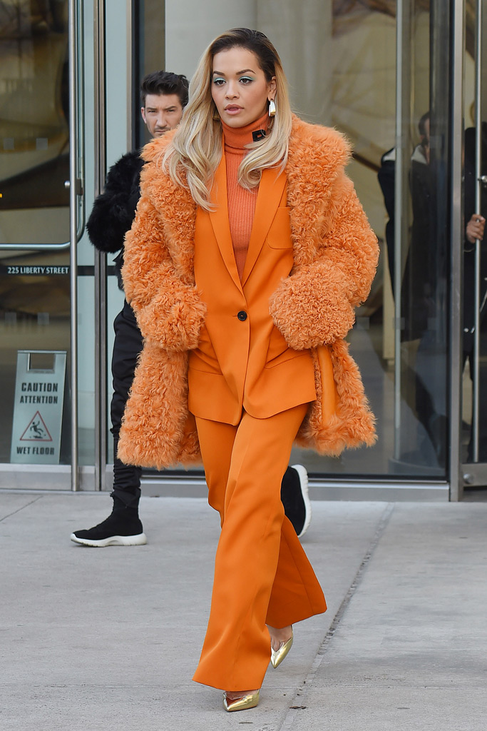 Rita Ora, orange pantsuit, teddy coat