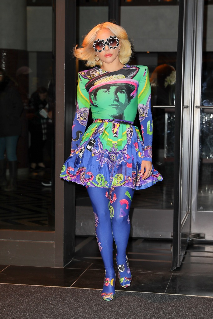 Lady Gaga steps out in a multi-colored Versace outfit in New York.