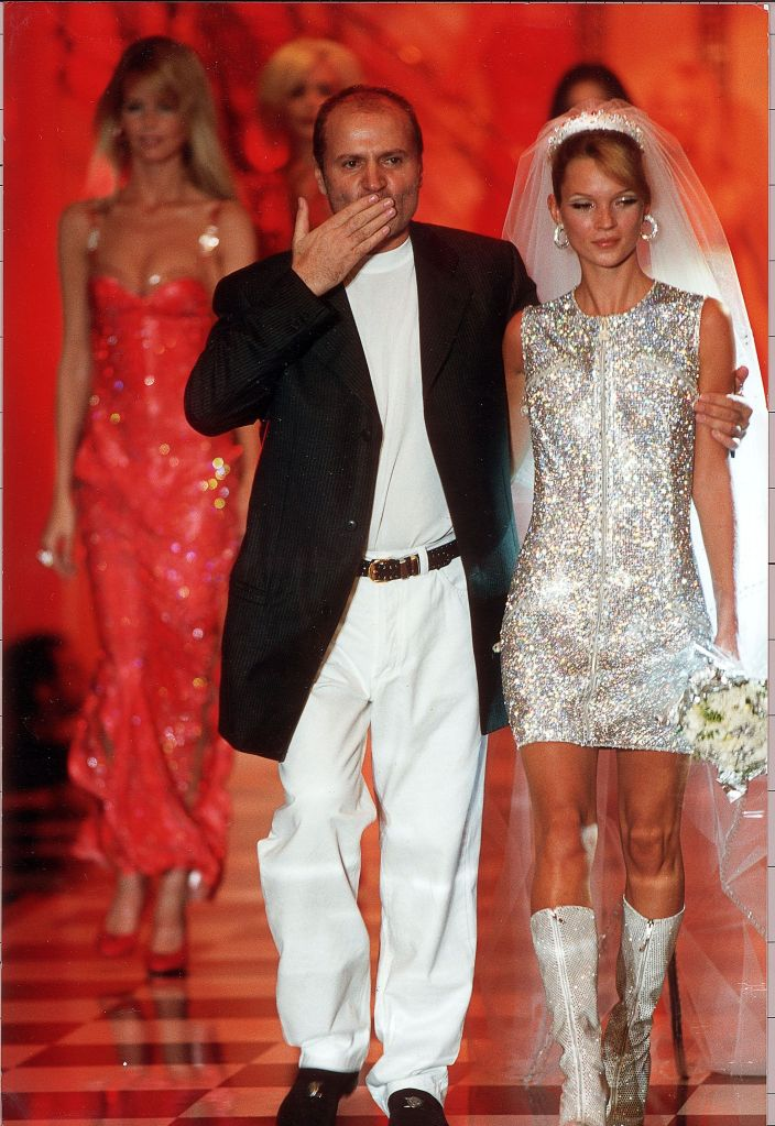 Paris Fashion Week - Fashion Designer Gianni Versace Pictured On The Catwalk At The End Of His Show With Model Kate Moss. Paris Fashion Week - Fashion Designer Gianni Versace Pictured On The Catwalk At The End Of His Show With Model Kate Moss.