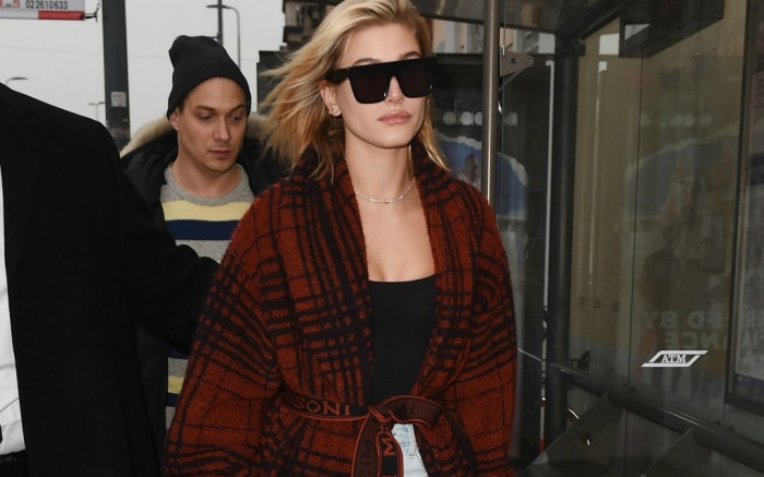 Hailey Baldwin opts for a comfy robe during Italy's Milan Fashion Week.